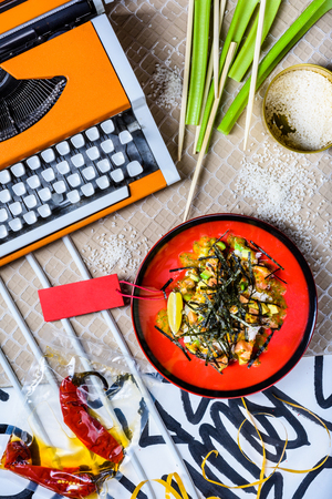 Poke bowl with salmon and rice. Asian cuisine. Healthy ingredients. Top view, flat lay. Reklamní fotografie