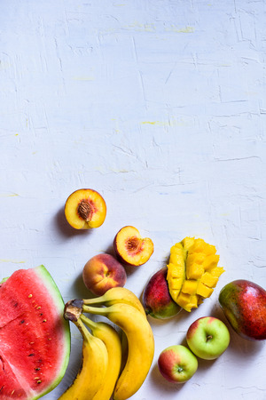 Fresh fruits. Raw organic tropical food background.Top view, copy space.