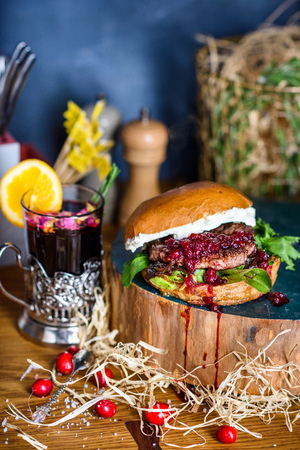 Burger with beef, cranberry jam and cream cheese. Close up. Reklamní fotografie