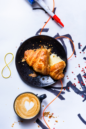 Coffee cup cappuccino art with freshly baked croissant for breakfast. Heart shape latte. Top view, copy space. Reklamní fotografie