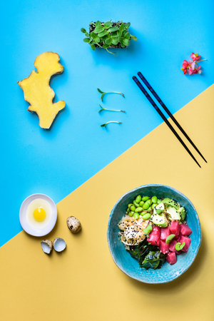 Hawaiian poke bowl with tuna and noodle and edamame. Asian trendy food sashimi. Top view, flat lay. Reklamní fotografie