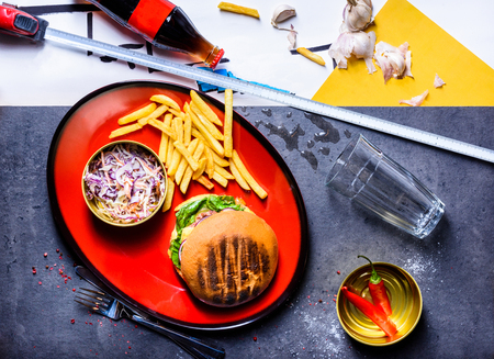 Delicious Beef Burger with french fries and pickled cabbage. Top view, copy space. Reklamní fotografie