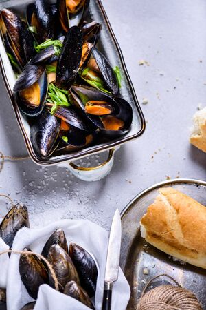 Mussels with with wine sauce. Clams in a shell, cooked seafood. Top view.