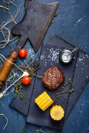 Beef Steak with a choper. Dry aged entrecote Steak with vegetables. Top view, copy space.