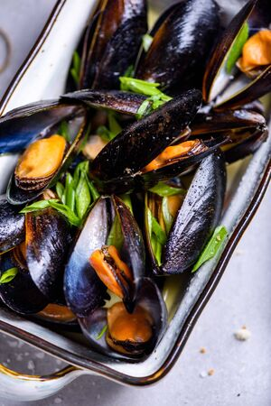 Close up mussels with with wine sauce. Clams in a shell, cooked seafood. Top view.