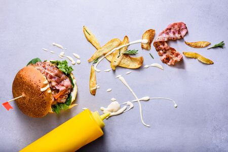 Burger with potato chips and bacon served with maionese. Copy space. Reklamní fotografie
