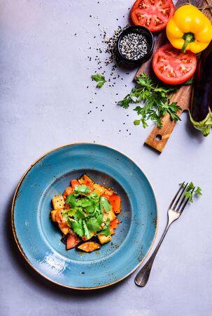 Vegetable Ragout with Fresh Herbs, vegetariad recipe with ingredients. Top view, copy space.