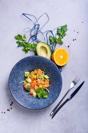 Poke bowl with Salmon and avocado. Clean eating.  Seafood salad recipe. Top view, copy space. Reklamní fotografie