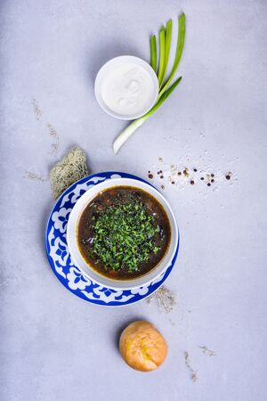 Soup in a bowl, with herbs and sour cream. Top view, copy space. Reklamní fotografie