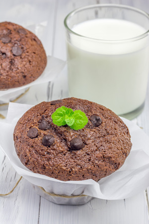choco chips: Delicious chocolate muffins with choco chips and glass of milk