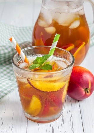 cold background: Glass of refreshing homemade nectarine iced tea Stock Photo
