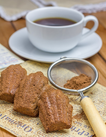 choco: Cocoa powdered choco madeleines with a cup of coffee