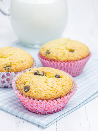 choco chips: Homemade muffins with choco chips and jar of milk Stock Photo