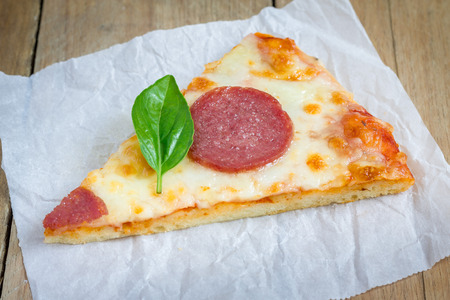 unsliced: Slice of homemade pepperoni pizza, ready to eat Stock Photo