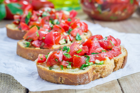 Bruschetta with tomatoes, herbs and oil on toasted garlic cheese bread