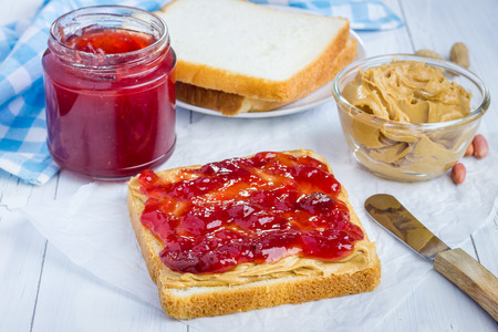 Sandwich with creamy peanut butter and strawberry jam