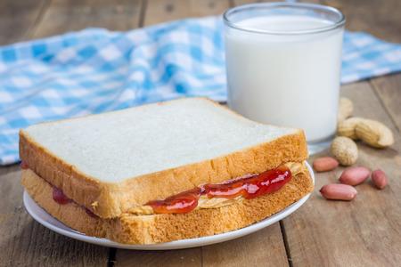 strawberry jam sandwich: Sandwich with creamy peanut butter and strawberry jam