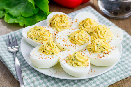Spicy deviled eggs sprinkled with paprika Stock Photo