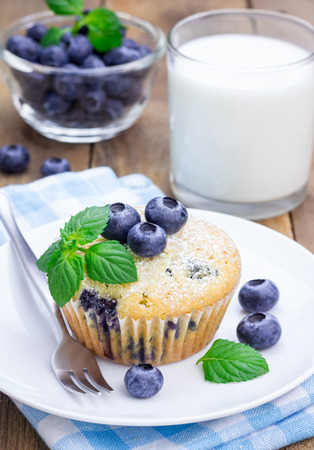 muffin: Homemade blueberry muffin with glass of milk