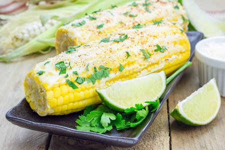 mexican: Mexican corn with butter, mayonnaise, parmesan, chili, cilantro, and lime