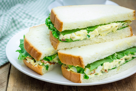 Sandwich with egg salad, bacon, green onion and lettuce 스톡 콘텐츠