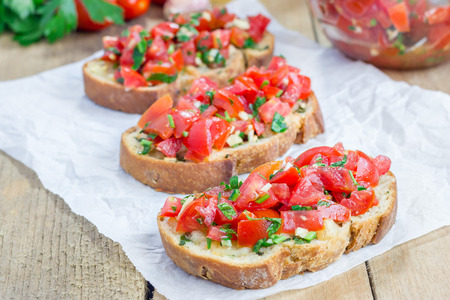 collation: Bruschetta with tomatoes, herbs and oil on toasted garlic cheese bread