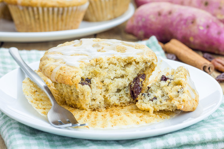 Citrus-glazed sweet potato muffins with pecan nuts and raisins