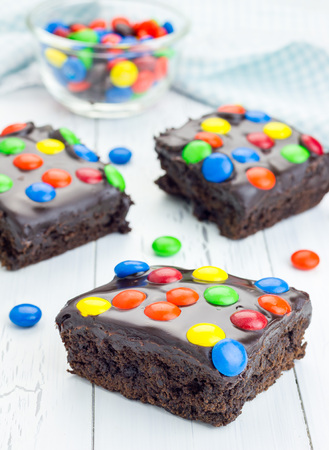 ganache: Homemade brownies with chocolate ganache and colorful candies