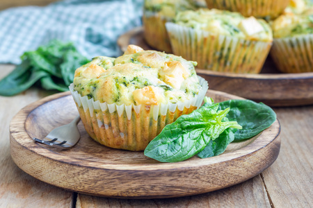 brunch: Snack muffins with spinach and feta cheese on a wooden plate Stock Photo