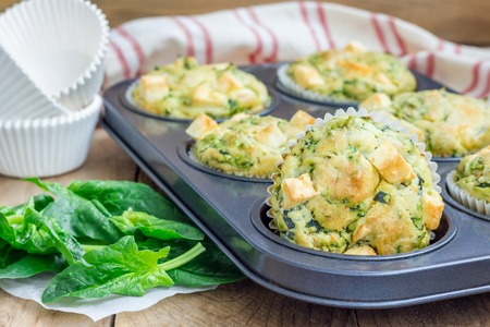 breakfast eggs: Freshly baked snack muffins with spinach and feta cheese Stock Photo