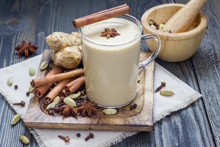 masala chai: Masala chai with spices. Cinnamon stick, cardamom, ginger, clove, star anise, black pepper. Stock Photo
