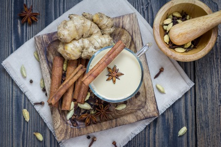 ginger: Masala chai with spices. Cinnamon stick, cardamom, ginger, clove, star anise, black pepper. Stock Photo