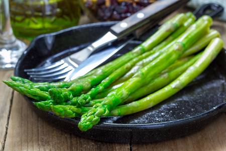 Freshly cooked asparagus appetizer on a cast iron skillet