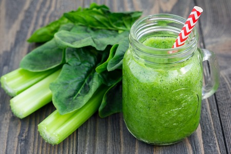 Green smoothie with celery, cucumber, spinach, apple and lemon