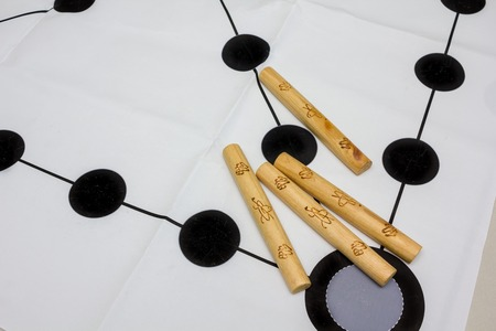 Korean traditional game yut nori, game background and wooden sticks Standard-Bild