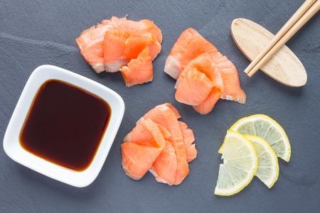 salmon filet: Smoked salmon filet with soy sauce on gray stone, horizontal
