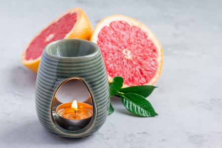 Aromatherapy lamp with grapefruit essential oil, copy space, horizontal Stock Photo