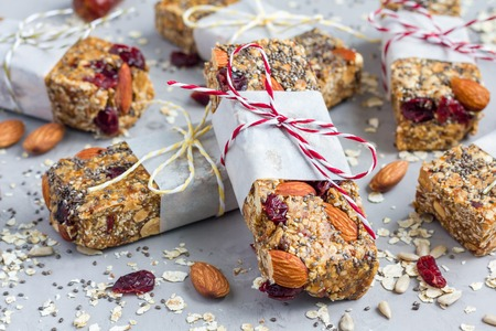 Homemade granola energy bars with figs, oatmeal, almond, dry cranberry, chia and sunflower seeds, healthy snack