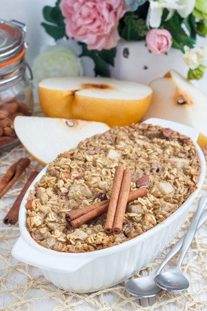 oatmeal: Baked oatmeal with nuts, almond milk, honey, spices and asian pear, vertical