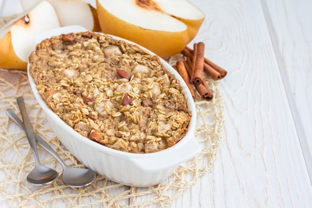 asian pear: Baked oatmeal with nuts, almond milk, honey, spices and asian pear, horizontal, copy space