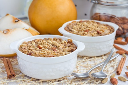 asian pear: Baked oatmeal with nuts, almond milk, honey, spices and asian pear, horizontal
