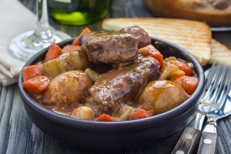 Hearty beef stew with carrot, celery, shallot and potato, horizontal Stock Photo