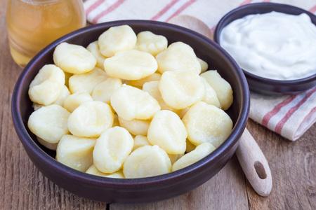 Traditional russian, ukrainian cottage cheese lazy dumplings served with yogurt and honey, horizontal