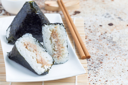 Korean triangle kimbap Samgak made with nori, rice and tuna fish, similar to Japanese rice ball onigiri. Horizontal, copy space 免版税图像