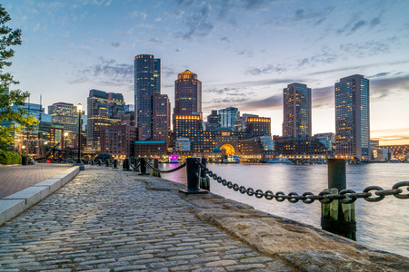 Boston Harbor and Financial District view from harbor on downtown, cityscape at sunset, Massachusetts, USA, horizontal