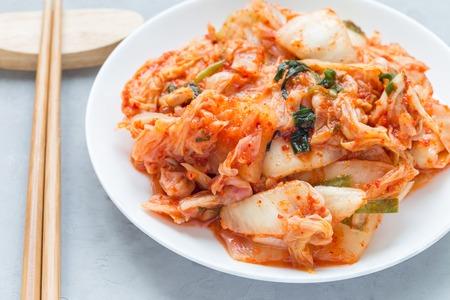 Kimchi cabbage. Korean appetizer on a white plate, horizontal, closeup Stock Photo