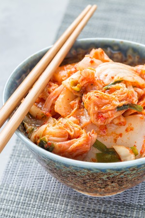 Kimchi cabbage. Korean appetizer in a bowl, vertical