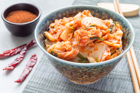 Kimchi cabbage. Korean appetizer in a bowl, horizontal