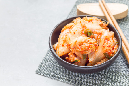 korean salad: Kimchi cabbage. Korean appetizer in a ceramic bowl, horizontal, copy space