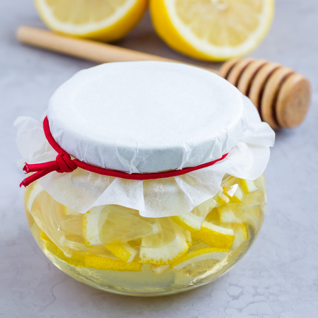 Lemon and honey mix for citrus tea in glass jar, ingredients on background, square format Stock Photo